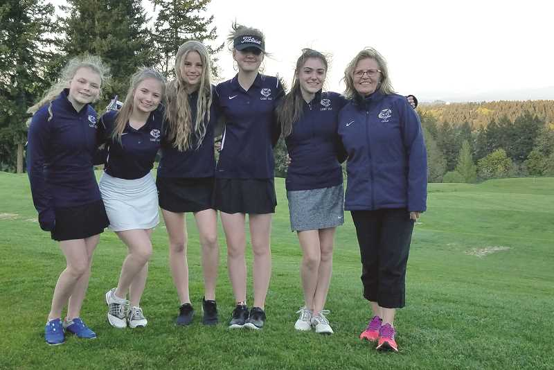 SUBMITTED PHOTO - From Left to Right: McKenna Moore, Sara Patton, Hannah Hughes, Gabby Holmberg, Elizabeth Krauss and coach Terry Bailey. Canby's girls golf team is poised to make strides in the next few years.