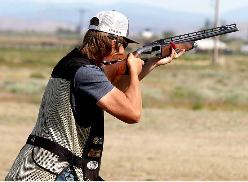 STEELE HAUGEN - Seth Colton shoots at a target during the High Desert Open Trap Shoot June 2.
