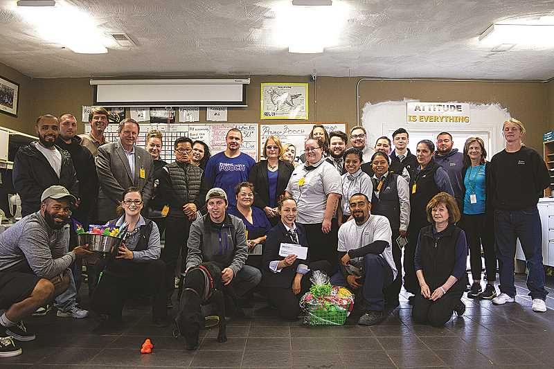 PATRICK EVANS - Students of the Project POOCH dog training and adoption program at MacLaren Youth Correction Facility celebrated POOCH's 25th anniversary with the newest donors to the program, managers from Woodburn MacDonald's.