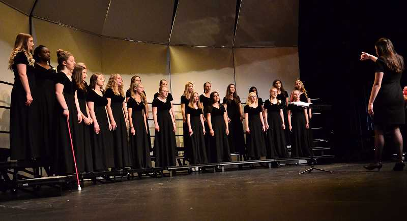 "SPOKESMAN PHOTO: VERN UYETAKE  - The Wilsonville High School concert choir performs the spiritual song ""Wade in the Water."""