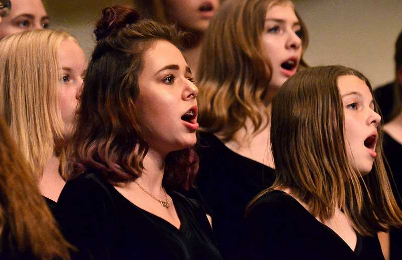 "SPOKESMAN PHOTO: VERN UYETAKE  - Freshman Emery Borgen and the rest of the Women's Choir sings ""Herbstied"" by Robert Schumann."