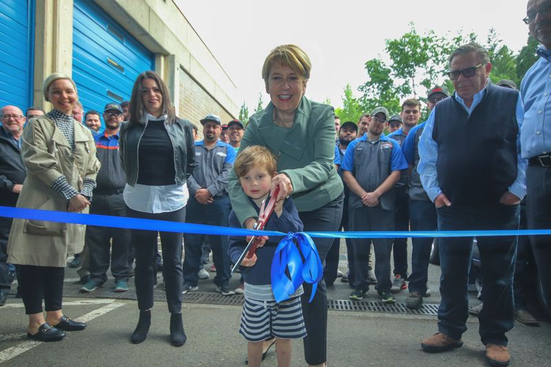 CONTRIBUTED PHOTO: GLENN WRIGHT, MHCC - Jenny Bailey, Erinn Sowle, left, and Jerry Jaksich watch as Nancy Jaksich and her grandson Fletcher Bailey cut the ribbon on the newly-named Jaksich Family Automotive Technology Center at Mt. Hood Community College.