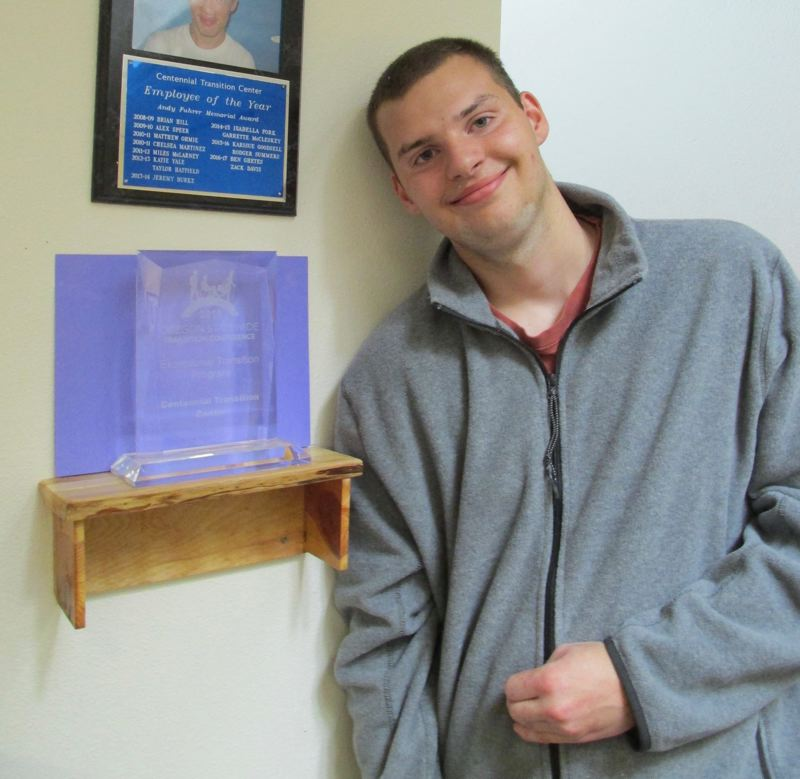 OUTLOOK PHOTOS: TERESA CARSON - 5. Nick, who works as a cashier at ACE Hardware, shows off a shelf he built for Centennial Transition Centers award as the 2018 Exceptional Transition Program of the year at the Oregon Statewide Transition Conference.