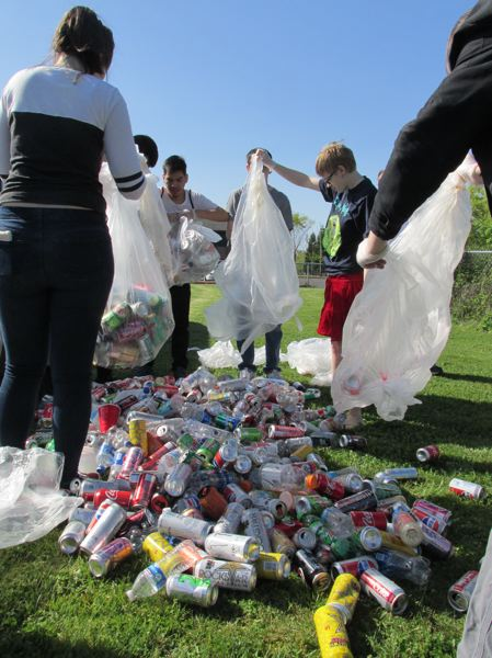OUTLOOK PHOTOS: TERESA CARSON - The Gresham-Barlow students get ready to sort the bottles and cans provided by ON Semiconductor.