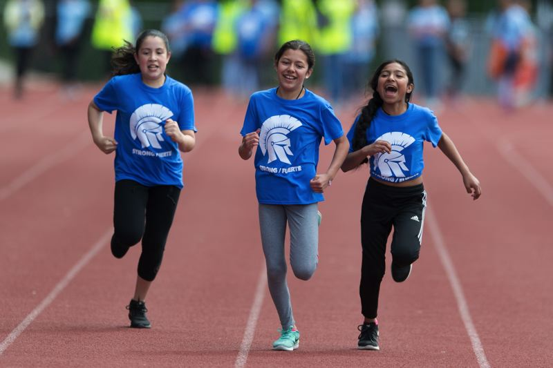STAFF PHOTO: CHRISTOPHER OERTELL - Several students competed in the 100 meter dash representing their feeder school, Hillsboro High School, during the meet.