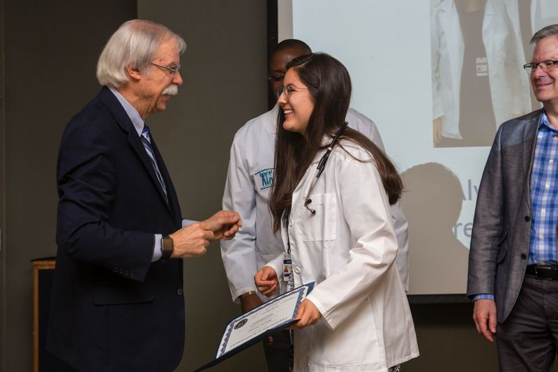 CONTRIBUTED PHOTO: ADVENTIST MEDICAL CENTER - Alyssa shares a joke with Dr. Wesley Rippey, the chief medical officer at Adventist Medical Center when she graduated from the program.