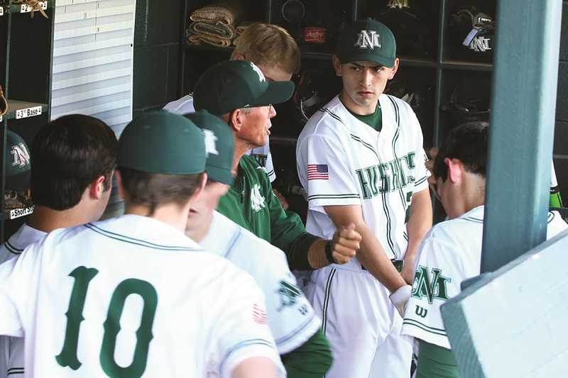 JO WHEAT - North Marion head baseball coach Randy Brack talks to his players as the Huskies head into the seventh inning of their semifinal game down 1-0 to the La Grande Tigers.