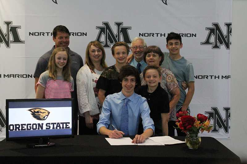 LINDSAY KEEFER - North Marion senior Logan Gianella signed a letter of intent to continue his music education at Oregon State University. Gianella is planning to double major in piano performance and biology.