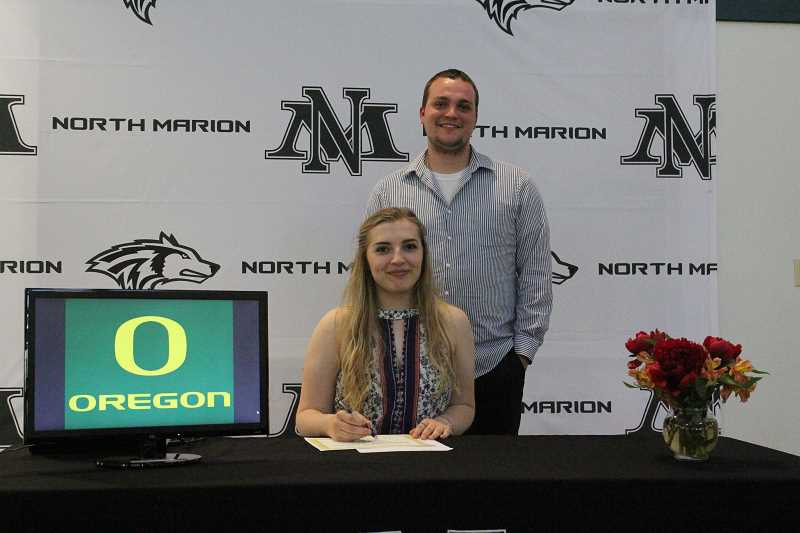 LINDSAY KEEFER - North Marion senior Mikayla Golka, pictured with  music teacher Kaden Christensen, signed her letter of intent to continue her music education at University of Oregon. Golka was admitted into the U of O school of music to play bassoon with plans to become a music teacher.