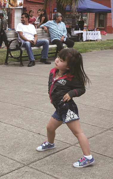 LINDSAY KEEFER - Taste of Woodburn was capped off with the Cuban Caribbean flavor of Dina y Los Rumberos, which not only had salsa competitors dancing, but also guests watching, including 3-year-old Sofia Alvarez, of Portland.