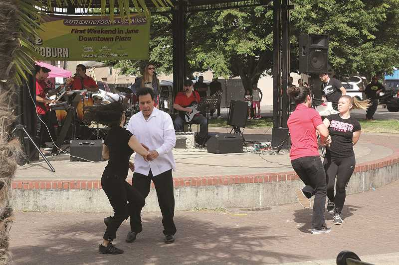 LINDSAY KEEFER - Dina Y Los Rumbreros performs music in the gazebo in the Downtown Plaza while salsa dancers entertain with their moves.