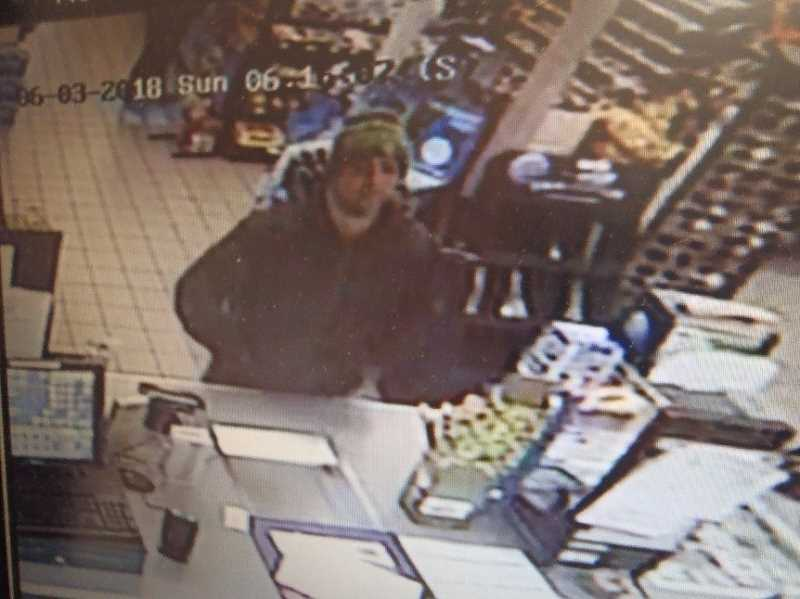COURTESY: SHERWOOD POLICE DEPARTMENT - The man in this photo is suspected of burglary and car theft. Sherwood Police are seeking help identifying him.