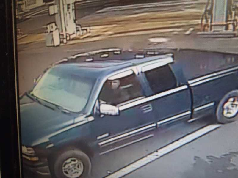 COURTESY: SHERWOOD POLICE DEPARTMENT - Sherwood Police are seeking assistance in identifying the driver of this stolen 1999 blue Chevy Silverado Z28 truck with the Oregon license plate number WVS950.