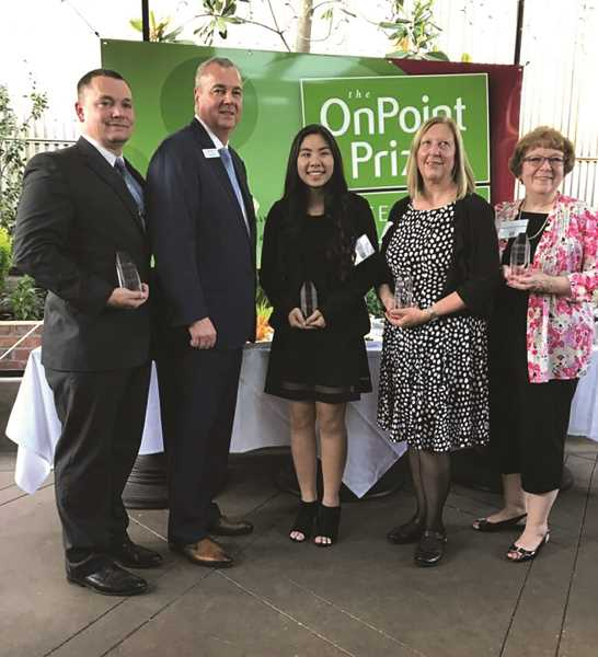 ONPOINT CCU - Gervais Elementary Principal Creighton Helms (left) accepted an Excellence in Education award from OnPoint Community Credit Union for GES recently.