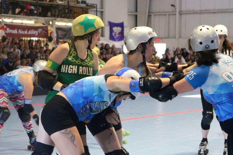TRIBUNE PHOTO: ZANE SPARLING - Players compete during the Season 13 championships for the Rose City Rollers on Saturday, June 2 at Oaks Amusement park.