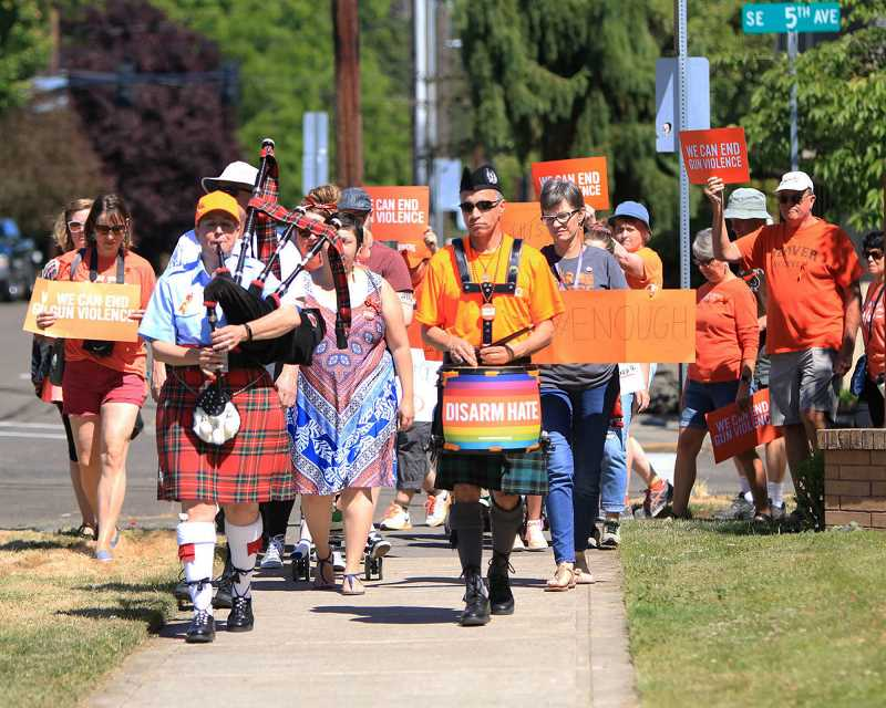 COURTESY ANNEMARIE JACQUES - Marchers make their way through downtown Hillsboro on June 2, in support of legislation to curb gun violence across the country.