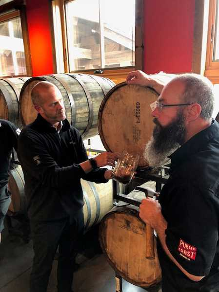 SUBMITTED PHOTOS: JOAN ROBBINS  - Public Coast Brewing Co. owner Ryan Snyder, left and Brewer Will Leroux talk about some of their specialty aged beers while pulling off some to taste.