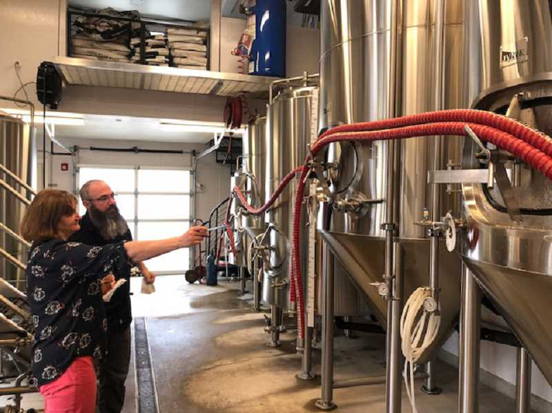Barb Randall and Public Coast Brewing Co. Brewer Will Leroux talk about the beer making process in the brewery.