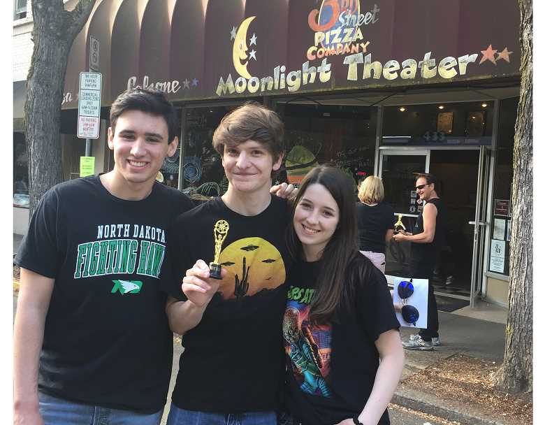 COURTESY: NOLEN STERNKOPF - Sherwood High School seniors Jack Weldon, Nolen Sternkopf and Skylar Smith pose outside of the Moonlight Theater on May 19 after winning first place at the McMinnville UFO Film Festival.