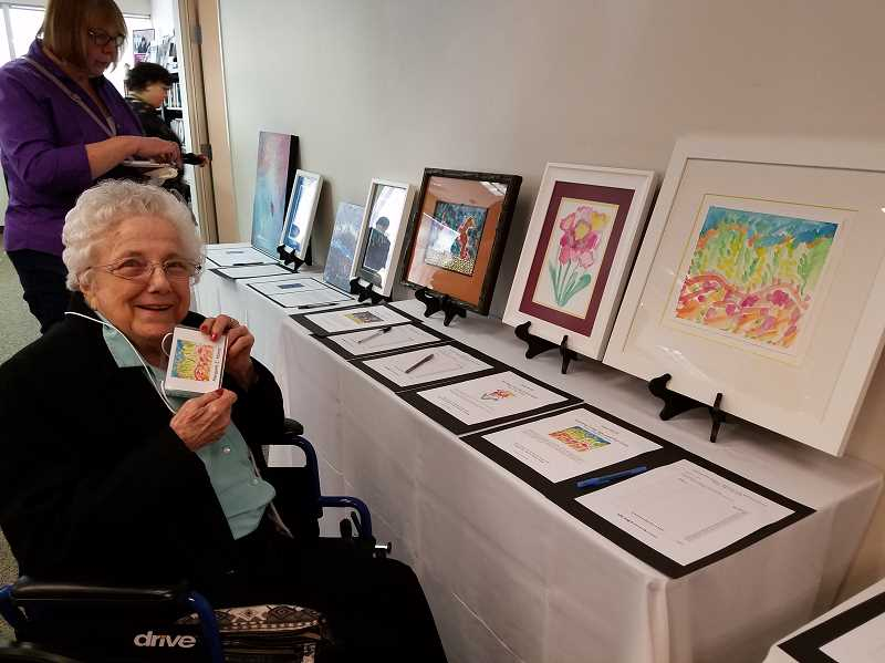 SUBMITTED PHOTO: LISA OETKEN - The Springs resident Margaret Hovey poses with her artwork at a recent Alzheimers Association Memories in the Making art show event.