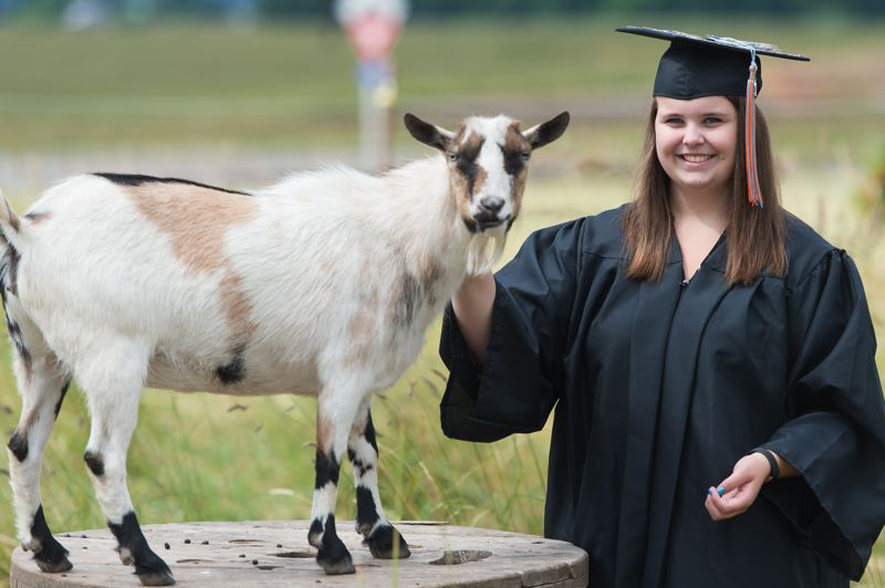STAFF PHOTO: CHRISTOPHER OERTELL - Kaitlyn Kautscheid, who lives out in Banks with her family and two pet goats, has been able to complete her school work from home over her high school career.