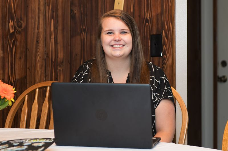 STAFF PHOTO: CHRISTOPHER OERTELL - Kaitlyn typically completes her school work from home, which has allowed her freedom to spend time volunteering and to work during a typical school day.