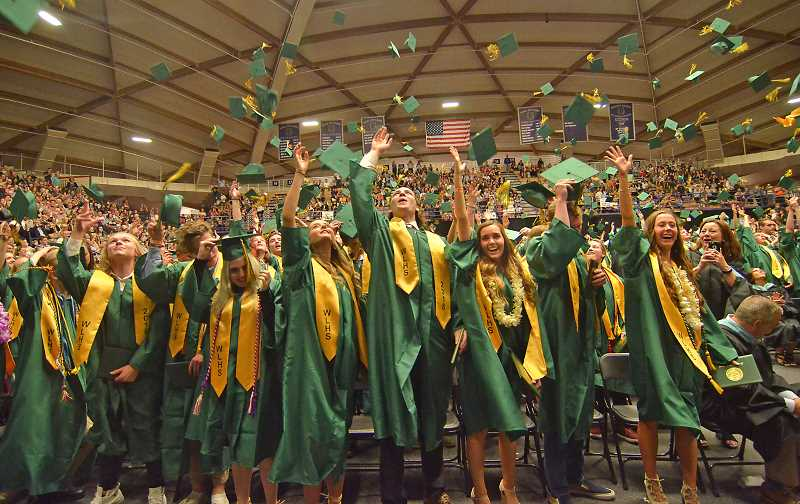 TIDINGS PHOTO: VERN UYETAKE  - The WLHS Class of 2018 graduates receive their diplomas June 5 at the University of Portland's Chile Center.