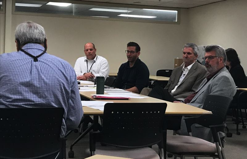 TRIBUNE PHOTO: SHASTA KEARNS MOORE - At a June 6 Health and Safety board committee meeting, from left to right, Day CPM project manager Mike Williams, Senior Director Dan Jung, Interim Senior Director John Burnham and Director Jere High speak with board member Mike Rosen (foreground).