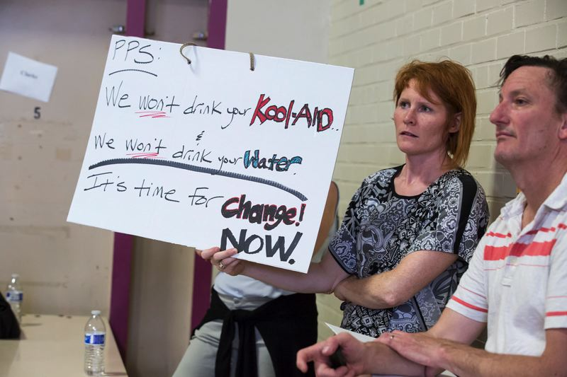 TRIBUNE FILE PHOTO - A woman expresses outrage at a community meeting on Portland Public Schools' lead-in-water issues in 2016 at Rose City Park School.