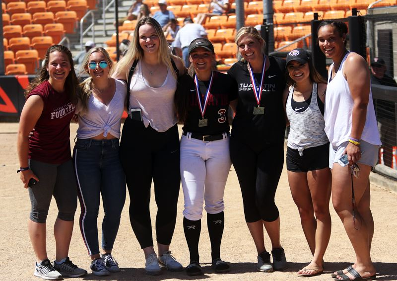 TIMES PHOTO: DAN BROOD - Members of the 2015 Tualatin championship softball team (from left), Amanda Reser, Tanna Baggenstos, Camryn Robbins, Taylor Alton, (current coach) Jenna Wilson, Caitlyn Sung and Nikki Miller were at Saturdays game.