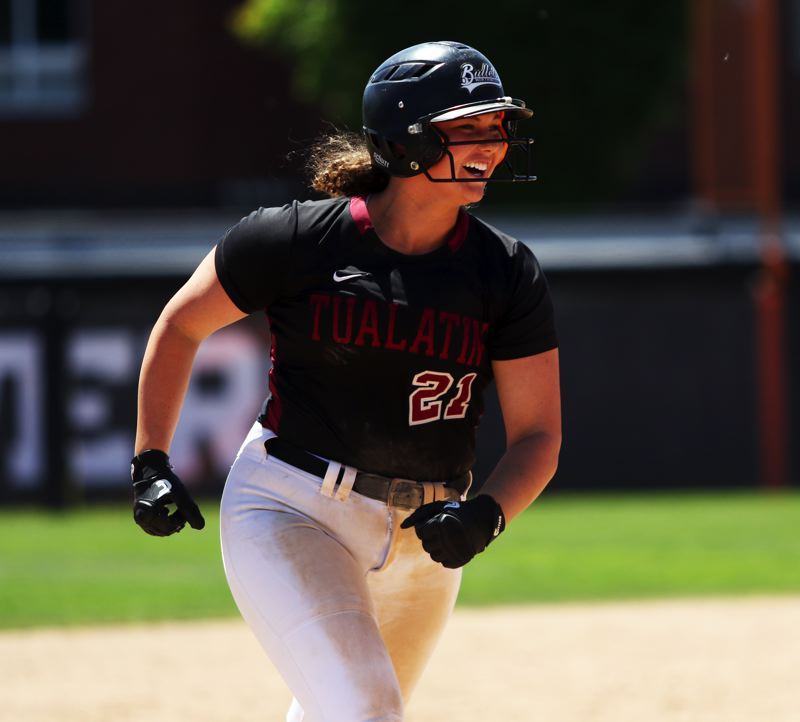 TIMES PHOTO: DAN BROOD - Tualatin High School junior Emily Johansen smiles as she circles the bases following her fifth-inning home run in Satrurdays championship game.