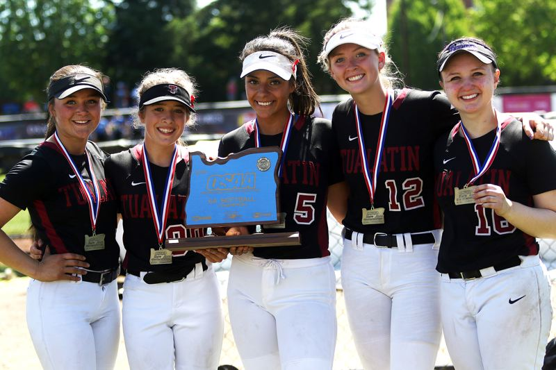 TIMES PHOTO: DAN BROOD - Tualatin seniors (from left) Taylor Alton, Kayla Laird, Zoe Olivera, Ella Hillier and Megan Woodward helped the Wolves win the championship trophy.