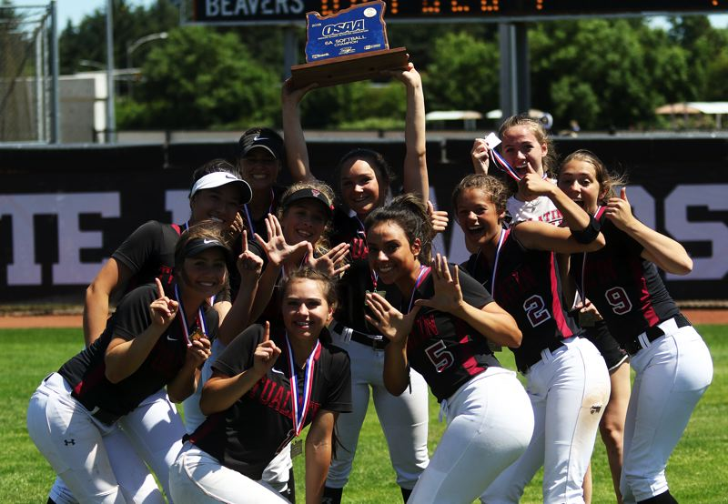 TIMES PHOTO: DAN BROOD - Members of the Tualatin High School softball team celebrate following their title-game win, which gave the squad a perfect 30-0 record.
