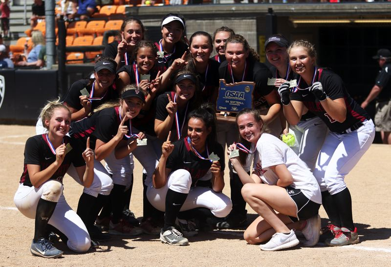 TIMES PHOTO: DAN BROOD - The Tualatin High School softball team claimed the state championship trophy, and went 30-0 on the season, with its 4-3 win over Clackamas on Saturday.