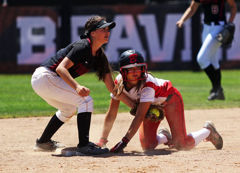 TIMES PHOTO: DAN BROOD - Tualatin High School junior second baseman Andrea Gomez (left) tags out Clackamas sophomore Madison Stateler during Saturdays state championship game.