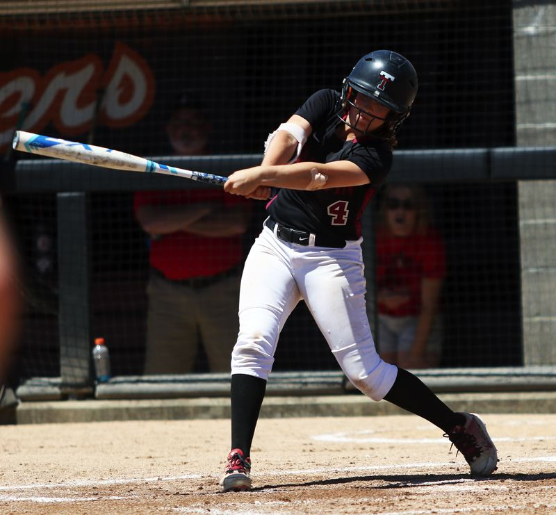 TIMES PHOTO: DAN BROOD - Tualatin leadoff hitter Bella Valdes takes a swing in the first inning of Saturday's state championship game.