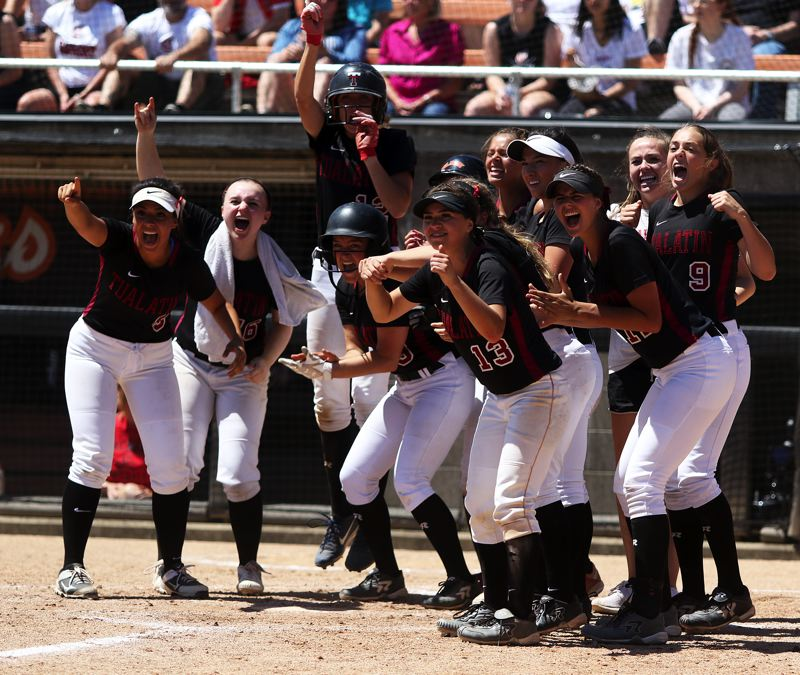 TIMES PHOTO: DAN BROOD - The Timberwolves wait to greet junior Emily Johansen at home plate following her two-run home run.