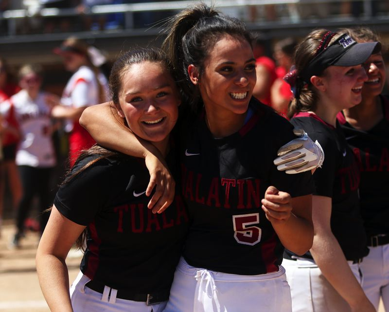 TIMES PHOTO: DAN BROOD - Tualatin seniors Taylor Alton (left) and Zoe Olivera both have big smiles on their faces following the 4-3 win over Clackamas in the Class 6A state championship game.