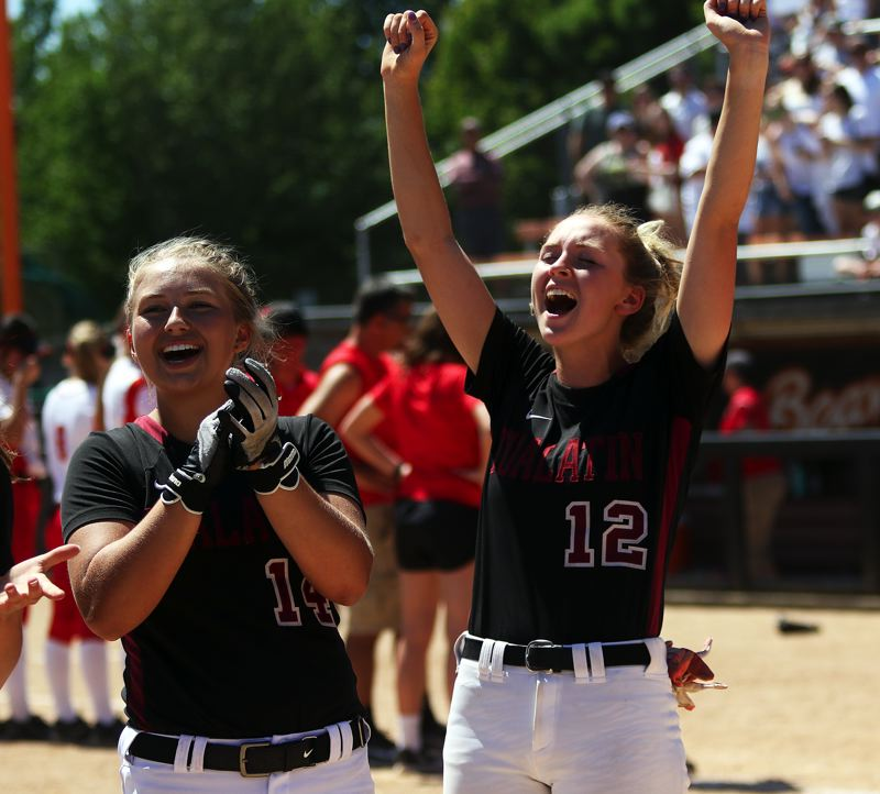 TIMES PHOTO: DAN BROOD - Tualatin freshman Taylor Corcoran (left) and senior Ella Hillier celebrate following the 4-3 win over Clackamas in the Class 6A state championship game.