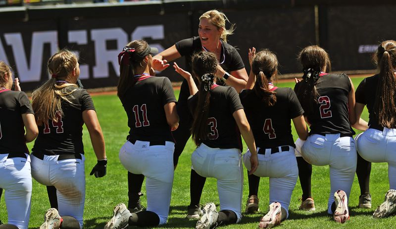TIMES PHOTO: DAN BROOD - Tualatin head coach Jenna Wilson congratulates her team following the 4-3 win over Clackamas in Saturday's Class 6A state championship game.