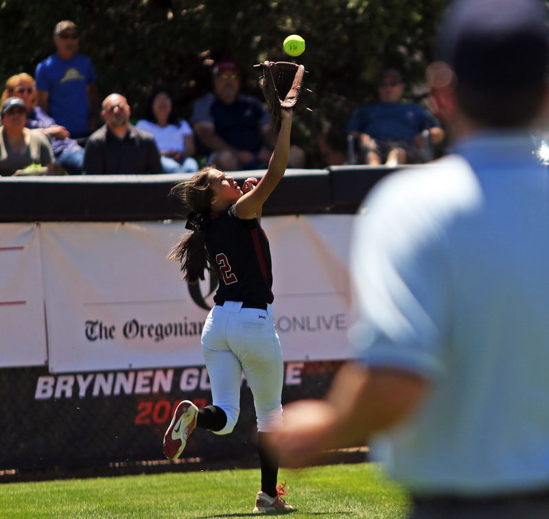 TIMES PHOTO: DAN BROOD - Tualatin sophomore left fielder Tia Ridings makes a running catch to start the game.