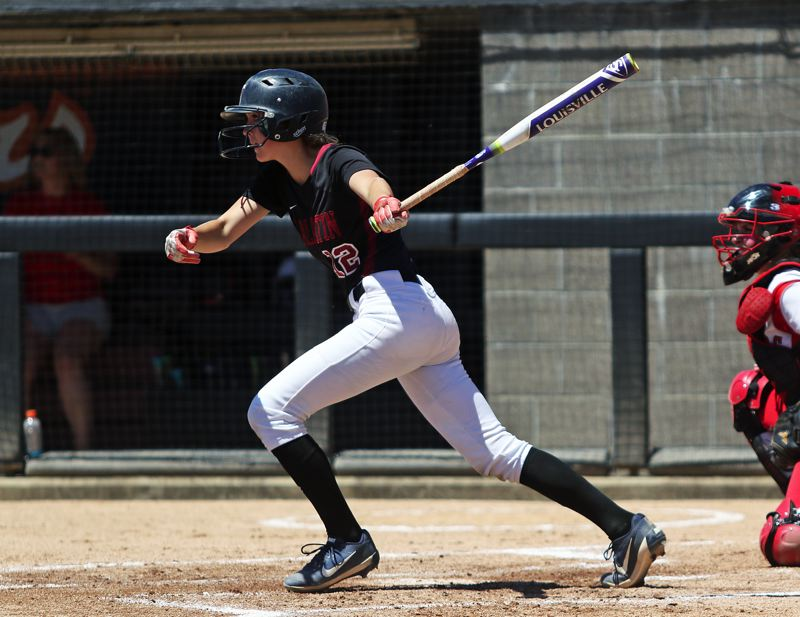 TIMES PHOTO: DAN BROOD - Tualatin senior Ella Hillier takes a swing during the bottom of the first inning.