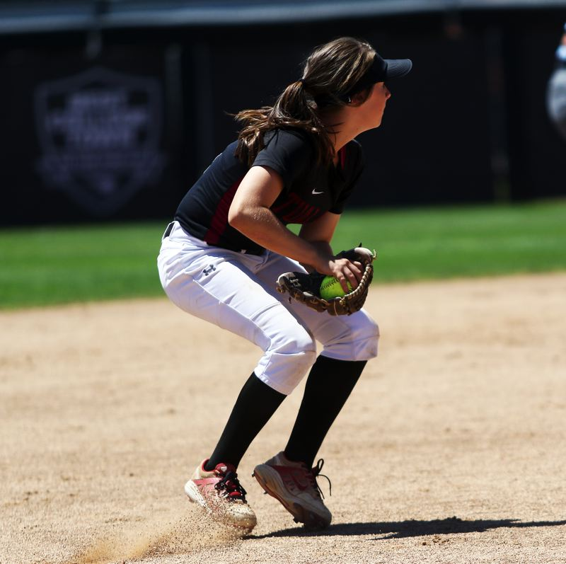 TIMES PHOTO: DAN BROOD - Tualatin sophomore shortstop Bella Valdes looks to make a throw to first after fielding a grounder.