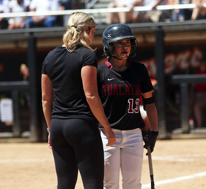 TIMES PHOTO: DAN BROOD - Tualatin head coach Jenna Wilson talks with junior Andrea Gomez prior to her at-bat.