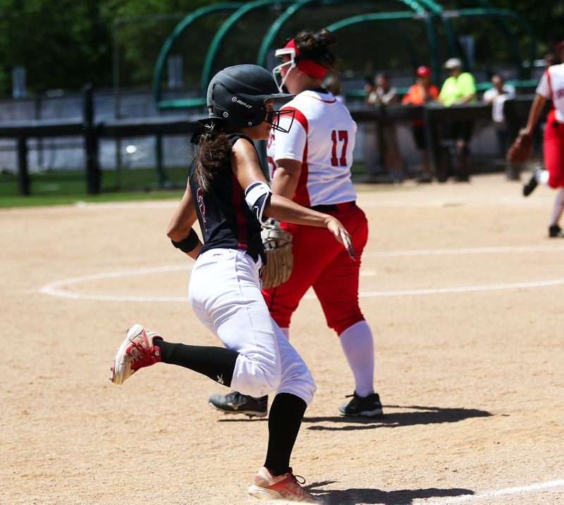 TIMES PHOTO: DAN BROOD - Tualatin sophomore Tia Ridings rounds third base on her way to scoring the Wolves' first run of Saturday's championship game.
