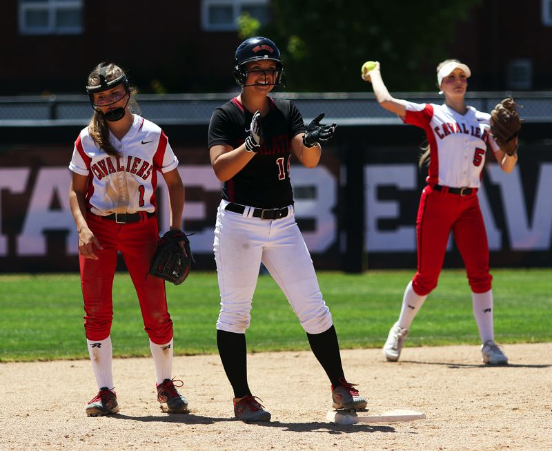 TIMES PHOTO: DAN BROOD - Tualatin sophomore Taylor Corcoran smiles after hitting a fourth-inning double.