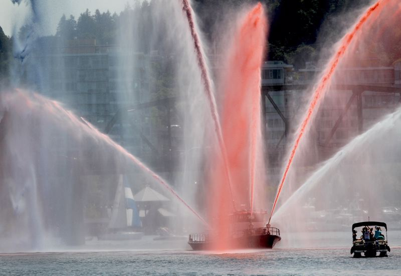 PAMPLIN MEDIA GROUP: JAIME VALDEZ - A Portland Fire Bureau fire boat led the vessels into the city with a spray display Wednesday afternoon, June 6.