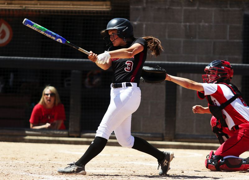 TIMES PHOTO: DAN BROOD - Tualatin senior Taylor Alton takes a swing during Saturday's Class 6A state championship game.