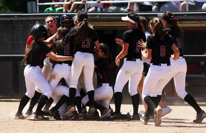 TIMES PHOTO: DAN BROOD - The Wolves celebrate following the game-winning run in Saturday's Class 6A state championship game.