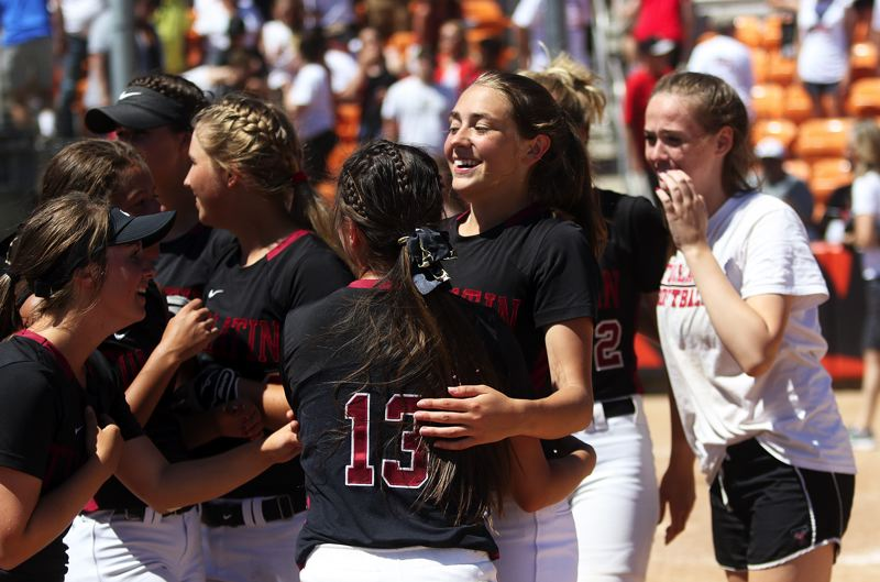 TIMES PHOTO: DAN BROOD - The Tualatin softball team was all smiles during the postgame celebration on Saturday.